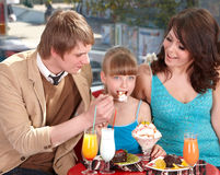 Family with child in cafe. Royalty Free Stock Photos