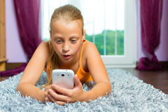 Family - child with cell or smartphone Stock Photo