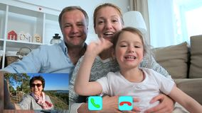 Family with Child Chatting with Grandmother Using Laptop Video Call Camera stock video