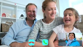 Family with Child Chatting with Grandmother Using Laptop Video Call Camera stock footage