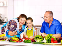 Family with child cooking at kitchen. Royalty Free Stock Photo