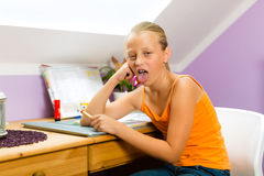 Family - child doing homework Stock Photography