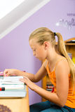 Family - child doing homework Stock Image