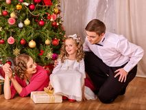 Family with children dressing Christmas tree. Royalty Free Stock Image