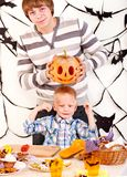 Family  with child holding make carved pumpkin. Royalty Free Stock Images