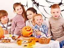 Family  with child holding make carved pumpkin. Royalty Free Stock Image