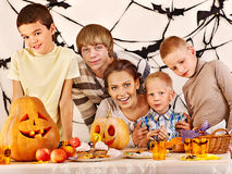 Family  with child holding make carved pumpkin. Stock Photography