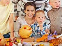 Family  with child holding make carved pumpkin. Royalty Free Stock Photos