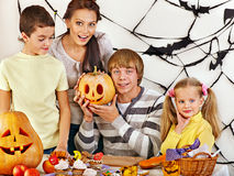 Family  with child holding make carved pumpkin. Stock Image