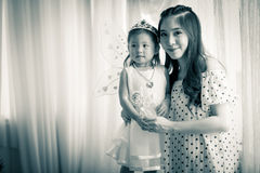Family, child and home concept - smiling parents and little girl Royalty Free Stock Photography
