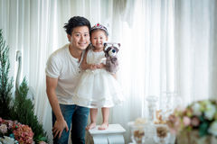 The family, child and home concept - smiling parents and little Royalty Free Stock Photos