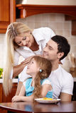 Family with the child on kitchen Stock Photos