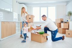 The family with the child moves to a new house. royalty free stock photo