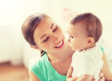 Happy young mother with little baby at home royalty free stock image