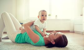 Happy mother playing with baby at home royalty free stock image