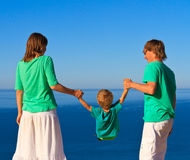Family with child playing on the beach Royalty Free Stock Photo
