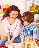 Family with child playing bricks. Stock Photography