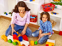 Family with child playing bricks. Stock Photo