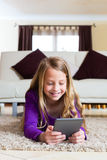 Family - child reading an E-Book Royalty Free Stock Image