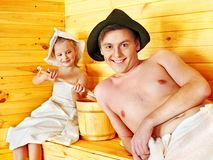 Family with child relaxing at sauna. Royalty Free Stock Photos