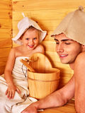 Family with child relaxing at sauna. Happy family with child relaxing at sauna. Father and daughter Royalty Free Stock Photography