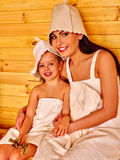 Family with child relaxing at sauna. Happy family with child and mother relaxing at sauna Royalty Free Stock Photos