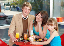 Family with child in restaurant. Stock Photography