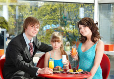 Family with child in restaurant. Royalty Free Stock Photos