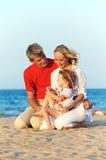 Family with child at sea beach. Happy family playing at red sea beach during sunset Royalty Free Stock Photos