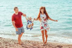 Family with child by the sea royalty free stock image