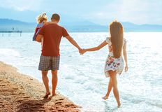 Family with child by the sea royalty free stock photography
