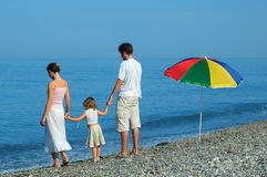 Family with child on seaside Royalty Free Stock Image