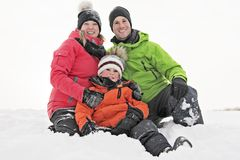 Family and child spending time outdoor in winter royalty free stock photo
