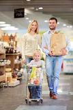 In a store. Family with child in a store Royalty Free Stock Photos