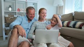 Family with Child Using Laptop Video Call Camera stock footage