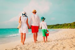 Family with child walking on beach. Family with child walking on tropical beach, vacation concept stock photography