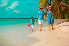 Family with child walking on tropical beach Royalty Free Stock Photos