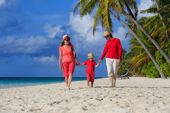 Family with child walking on tropical beach Royalty Free Stock Photography