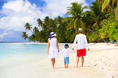 Family with child walking on tropical beach Royalty Free Stock Photo