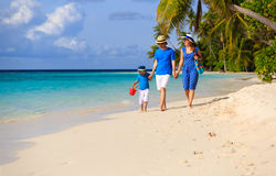 Family with child walking on tropical beach Royalty Free Stock Images