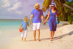 Family with child walking on tropical sand beach Stock Image