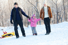 Family with child walking in a winter park Royalty Free Stock Photos