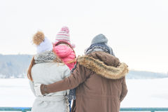 Family with child in winter holiday trip. Family with child together in winter holiday trip in the nature Stock Photo