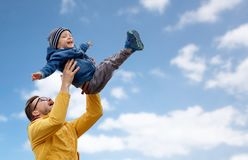 Father with son playing and having fun outdoors Royalty Free Stock Photo