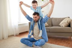 Father with son playing and having fun at home. Family, childhood, fatherhood, leisure and people concept - happy father and little son playing and having fun on Stock Photo