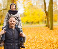 Happy family having fun in autumn park royalty free stock photos