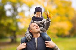 Happy family having fun in autumn park stock photography