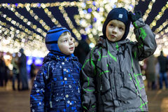 Family, childhood, season and people concept - happy in winter c Royalty Free Stock Photography