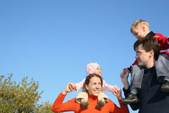 Family with children. On shoulders