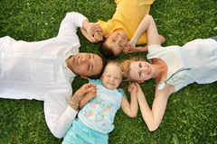 Family with children. Lying family with children grass Stock Images